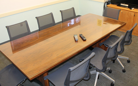 Small conference room with a long table surrounded by 8 chairs for Eugene Event Facilities page.